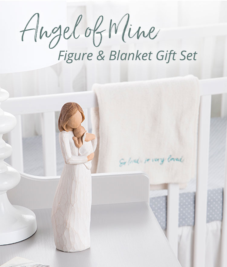 Mom and baby figurine and soft white baby blanket in baby nursery